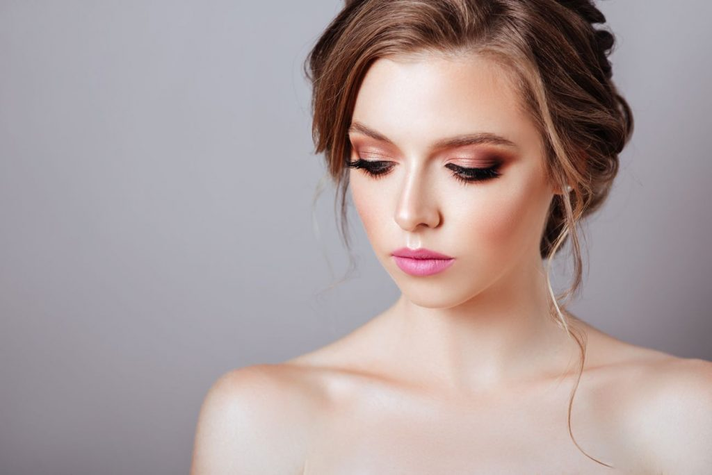 Fashion model posing at studio with makeup