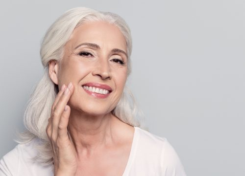 Older woman experiencing facial volume loss