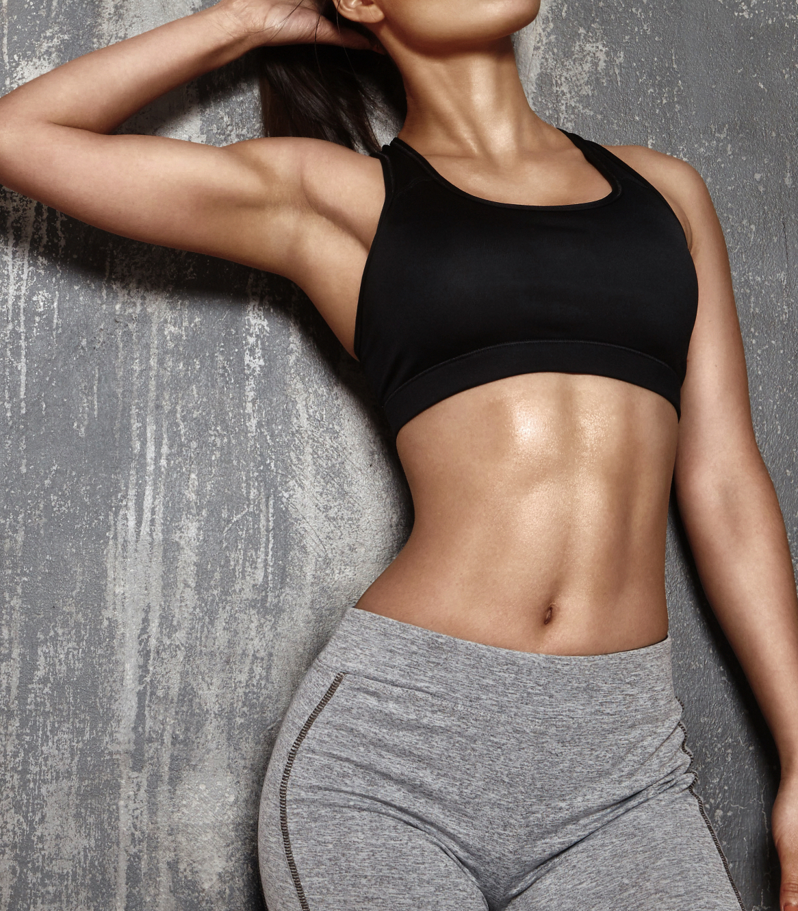 Muscular woman's body with abs